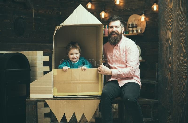 Education and kid idea development. Family and childhood. Earth day concept. father day. Father and small boy in paper. Rocket. Travel and adventure. Dream stock images