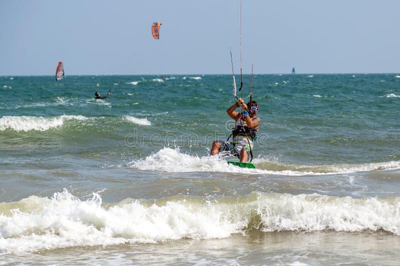 Education kite surfer rides the waves sea water splash, attractive sport sea. Mui Ne Coco Beach. Vietnam stock photos