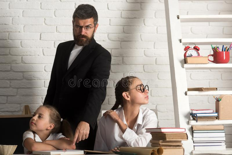 Education and knowledge day. education of little girls sitting at school lesson royalty free stock images