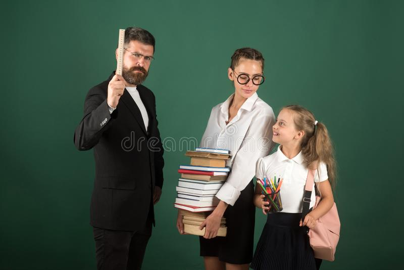 Education in knowledge day. education at school of small girl and her teen sister. stock photo