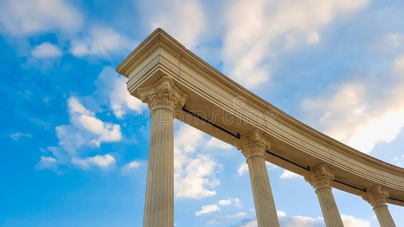 Education old pillars, columns. Education, law, court or city hall old Roman or Greek style architecture pillar columns and blue sky royalty free stock photos