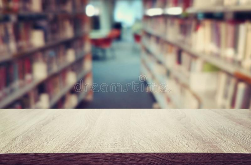 Education and learning concept of empty wooden table in library. for product display, presentation and back drop stock image