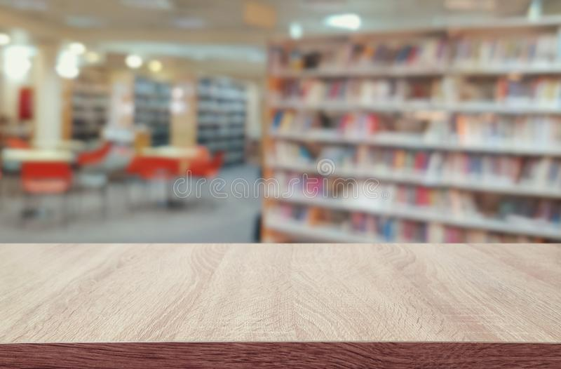 Education and learning concept of empty wooden table in library. for product display, presentation and back drop royalty free stock photo