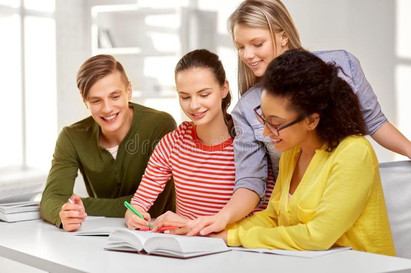 High school students with books and notebooks stock image