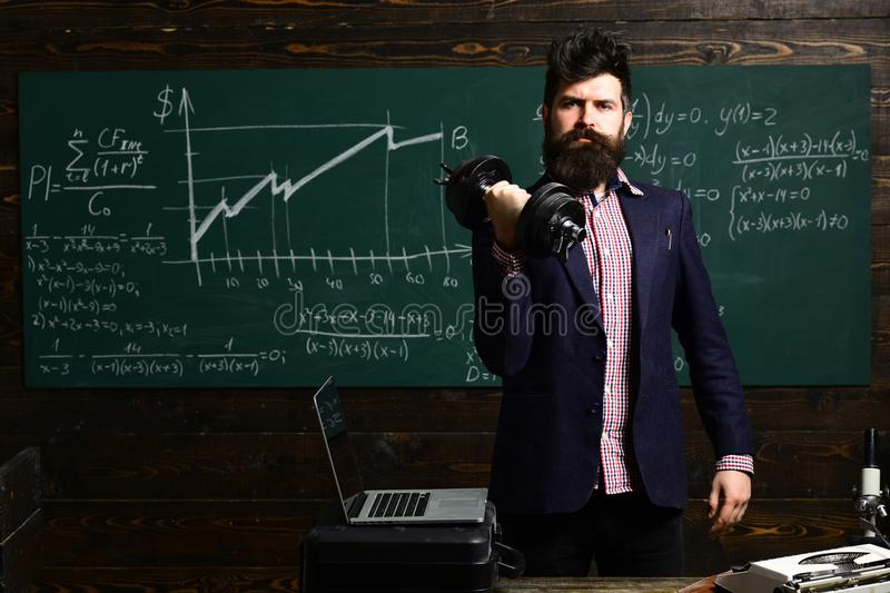 Education and literacy concept - high school teachers give lectures in classroom. Teacher sets high expectations for his stock photo