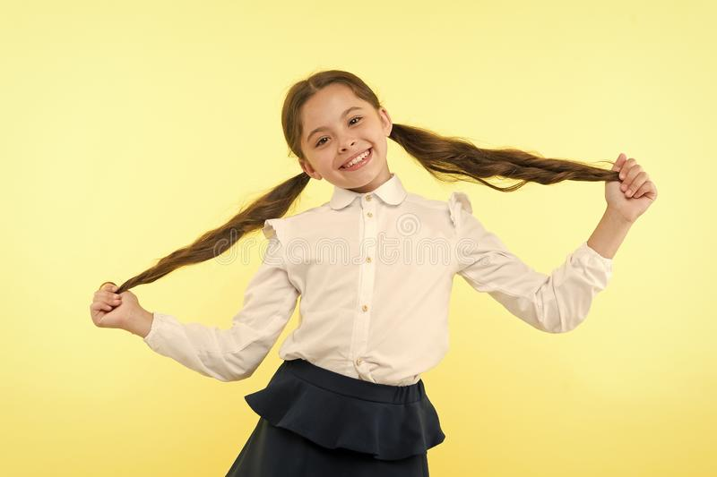 Education online. small girl child. private teaching. happy little girl in school uniform. Back to school. Childhood stock photos