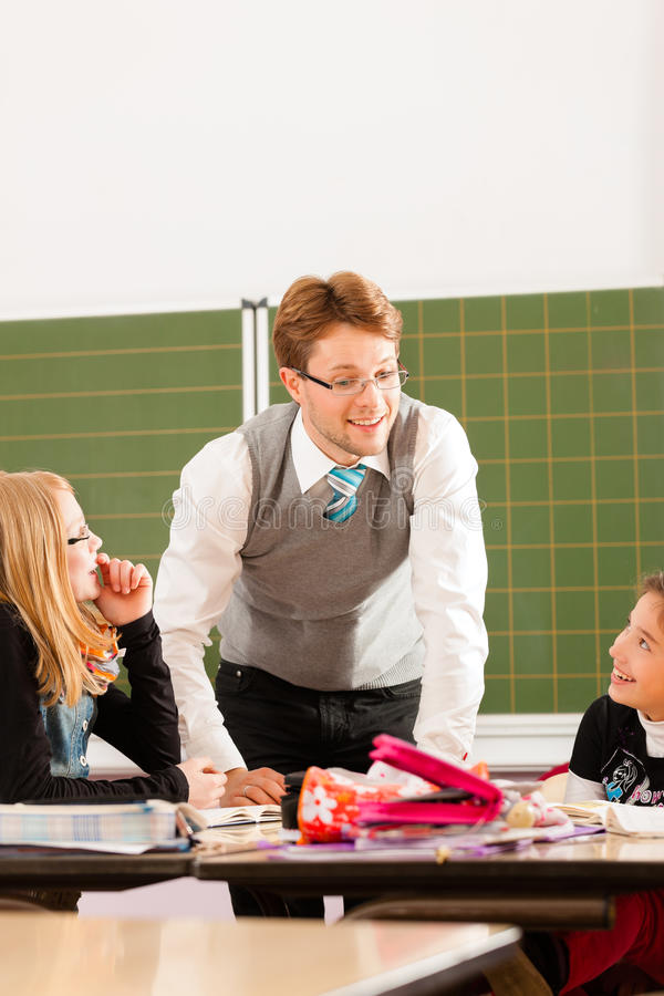 Education - Pupils And Teacher Learning At School Royalty Free Stock Photo