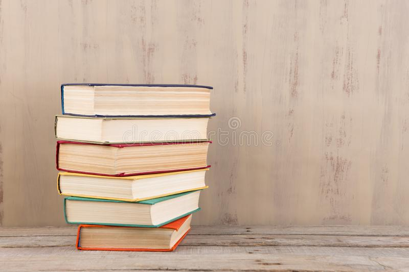 Education and reading concept - group of colorful books on the wooden table stock images