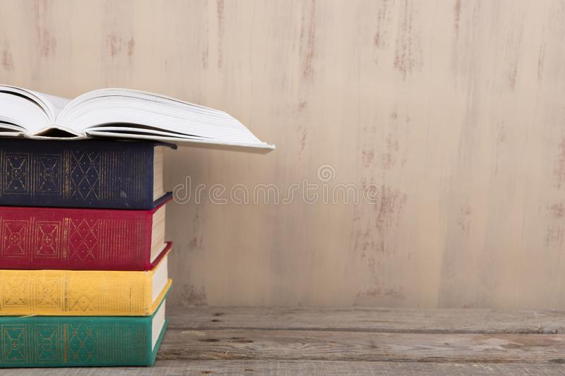 Education and reading concept - group of colorful books on the wooden table royalty free stock photo