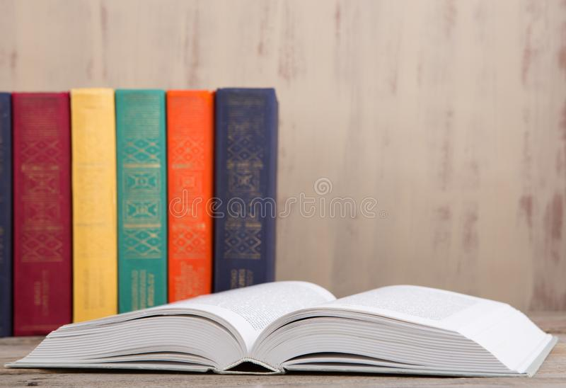 Education and reading concept - group of colorful books on the wooden table. Stack, school, textbook, wisdom, green, yellow, background, university, knowledge stock photo