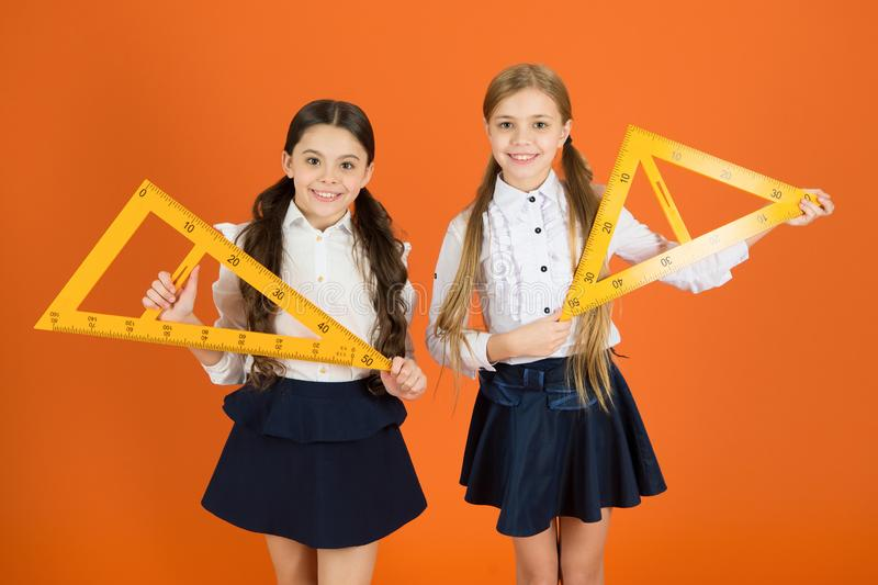 Education and school concept. School students learning geometry. Kids school uniform on orange background. Pupil cute stock images