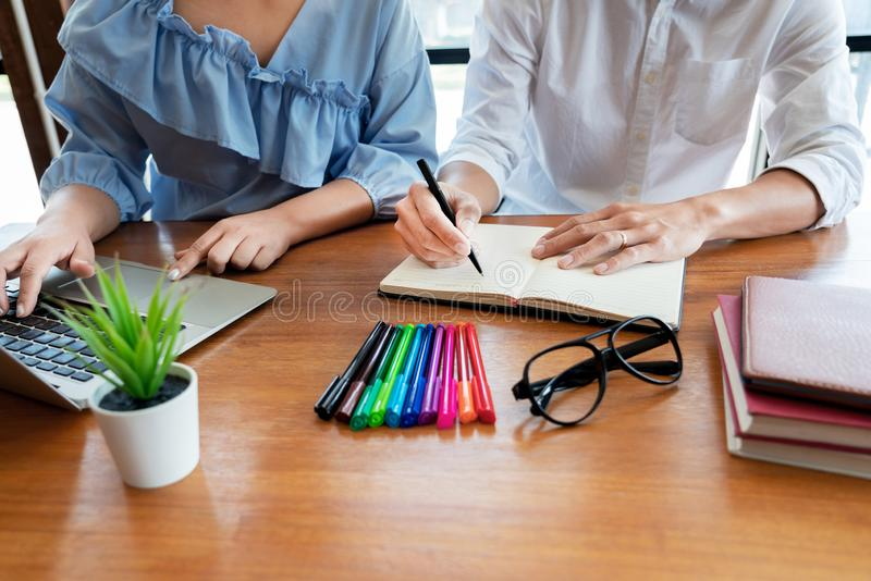 education and school concept, students campus or classmates learning tutoring catching up friend for a test or an exam in stock images
