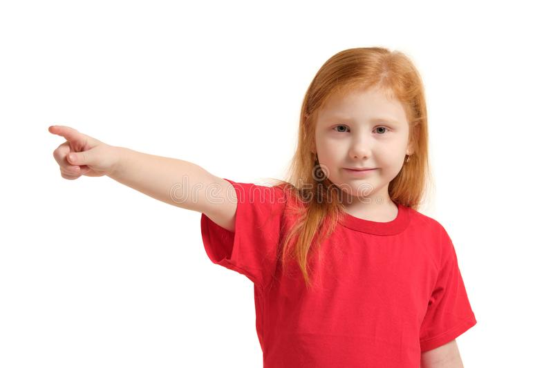 Education, school and imaginary screen concept - cute little girl pointing in the air or imaginary screen. Education, school and imaginary screen concept - cute stock photography