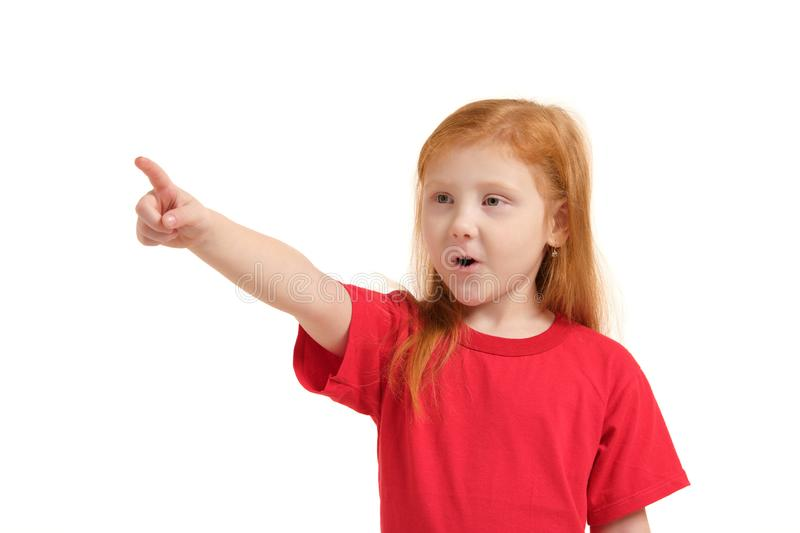 Education, school and imaginary screen concept - cute little girl pointing in the air or imaginary screen. Education, school and imaginary screen concept - cute royalty free stock photos