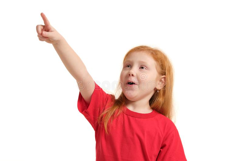 Education, school and imaginary screen concept - cute little girl pointing in the air or imaginary screen. Education, school and imaginary screen concept - cute stock images