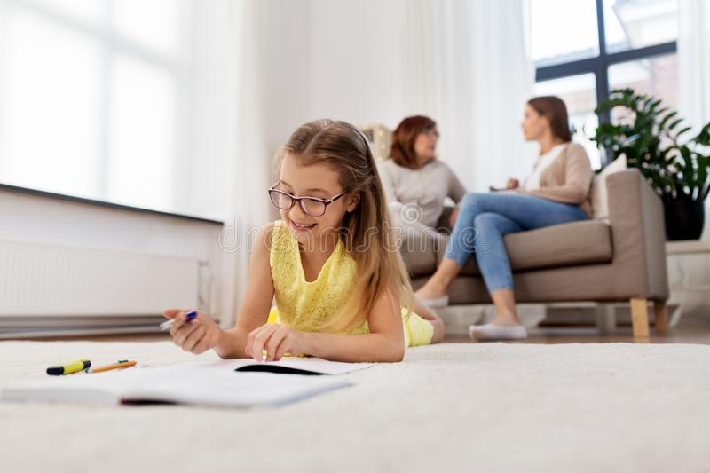 Student girl writing to notebook at home royalty free stock image