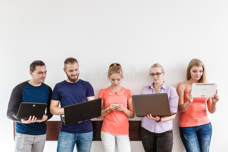 Diversity students learning using technology stock photography