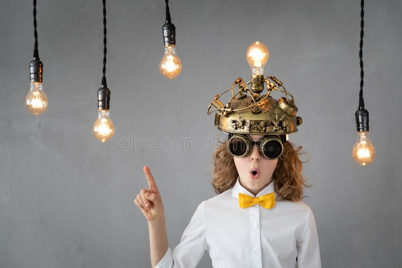 Education, start up and business idea concept. Smart child pretend to be businessmen. Funny kid playing at home. Education, start up and business idea concept royalty free stock images