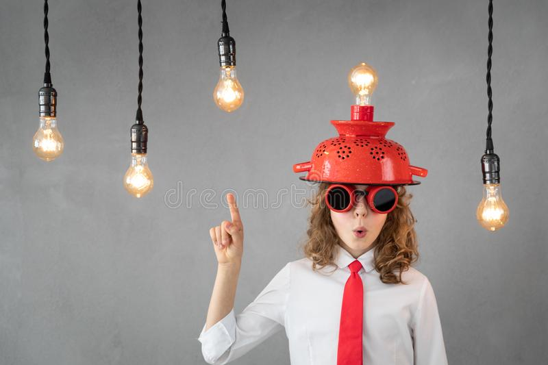 Education, start up and business idea concept. Smart child pretend to be businessmen. Funny kid playing at home. Education, start up and business idea concept stock photos