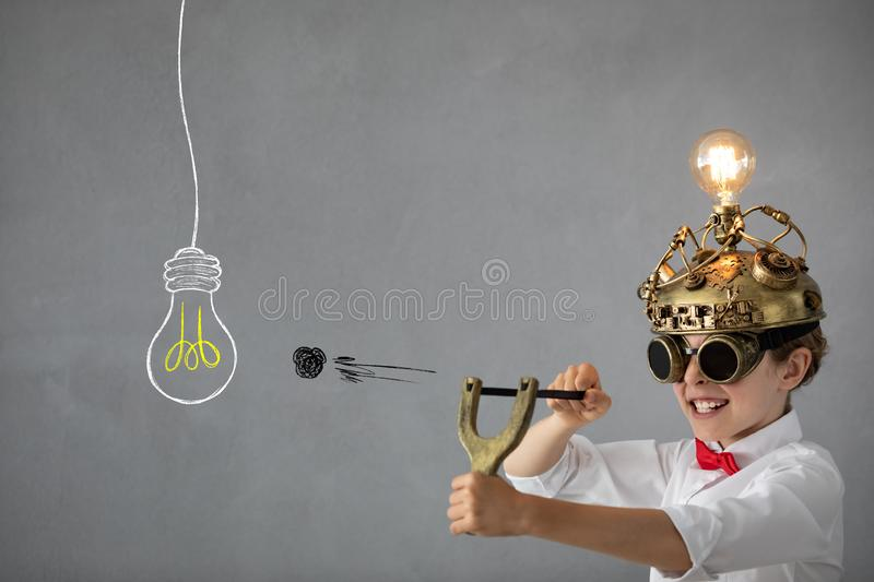 Education, start up and business idea concept. Smart child pretend to be businessmen. Funny kid playing at home. Education, start up and business idea concept royalty free stock photos