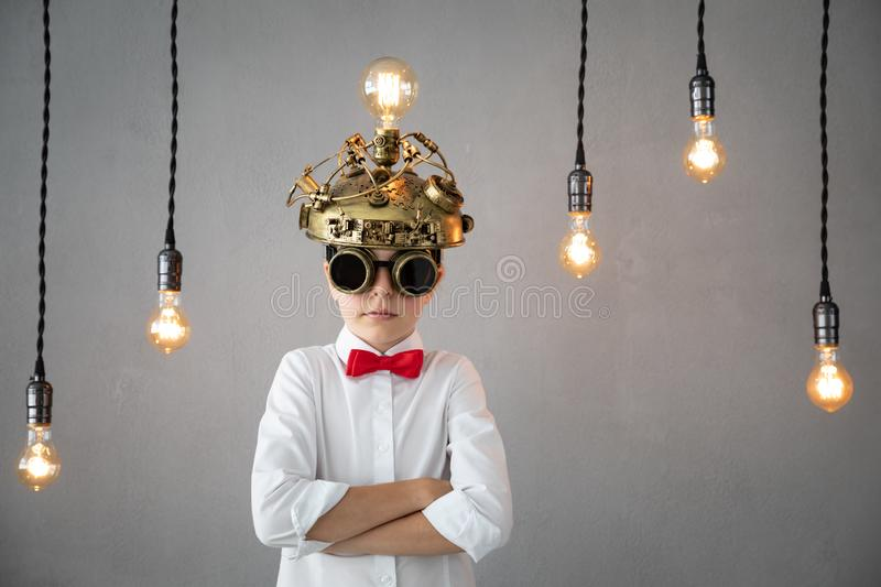 Education, start up and business idea concept. Smart child pretend to be businessmen. Funny kid playing at home. Education, start up and business idea concept royalty free stock photo