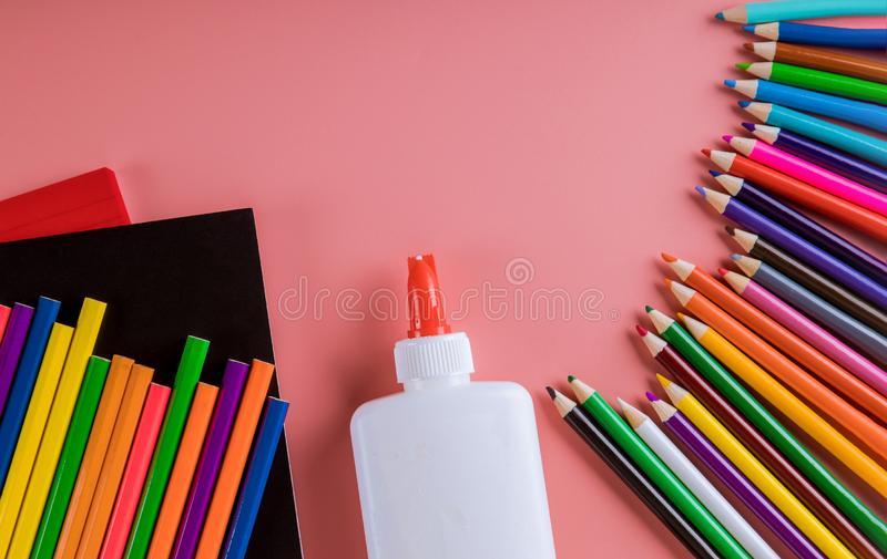 School supplies on pink background, back to school stock photos