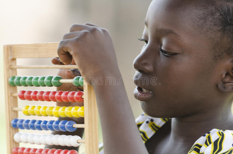 Education symbol: Little African girl learning to count stock photo