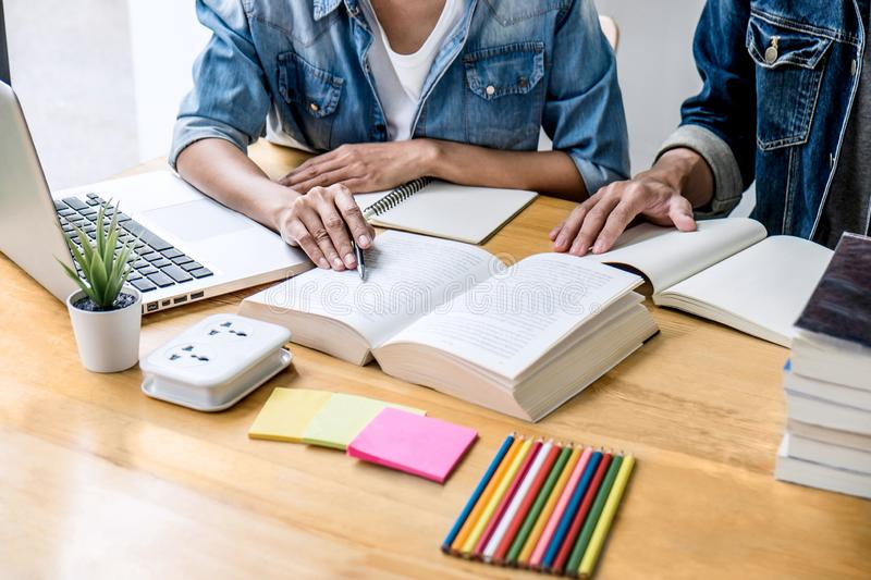 Education, teaching, learning concept. High school students or classmates group tutor in library studying and reading with helps. Friend doing homework and royalty free stock photos