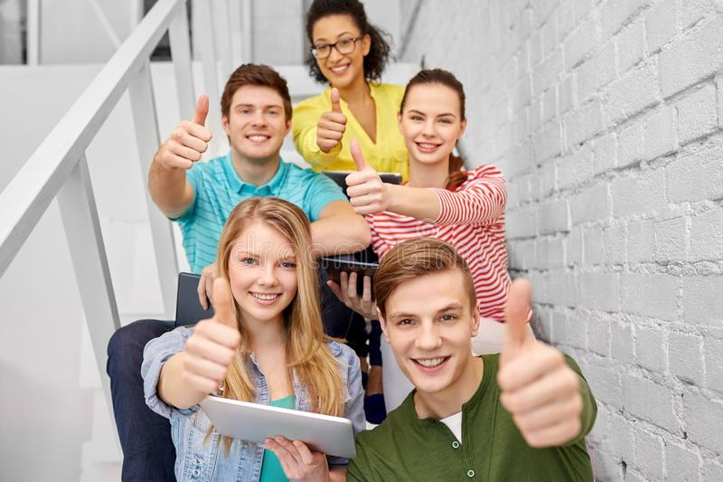 High school students with tablet computers stock image
