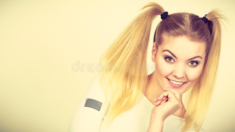 Happy blonde teenager girl with ponytails royalty free stock photography