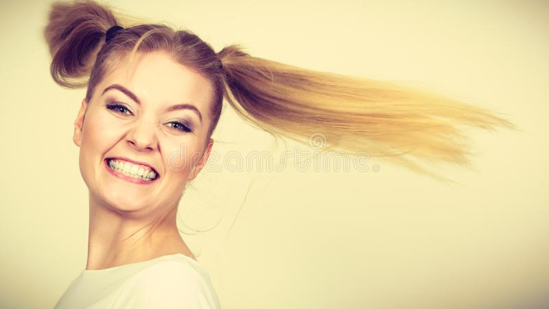 Happy blonde teenager girl with ponytails stock photo