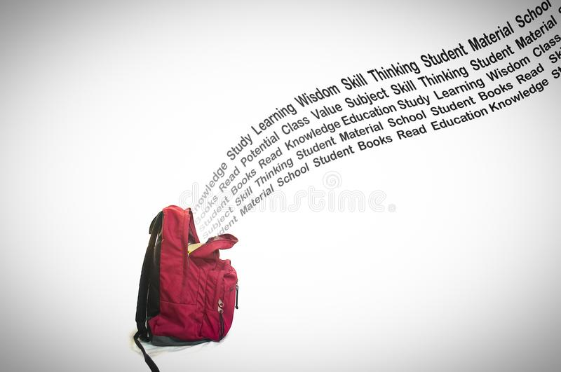 Education Typography Coming out of the School Bag on White Background. Typography about education visually coming out from the school bag. white background royalty free stock photo