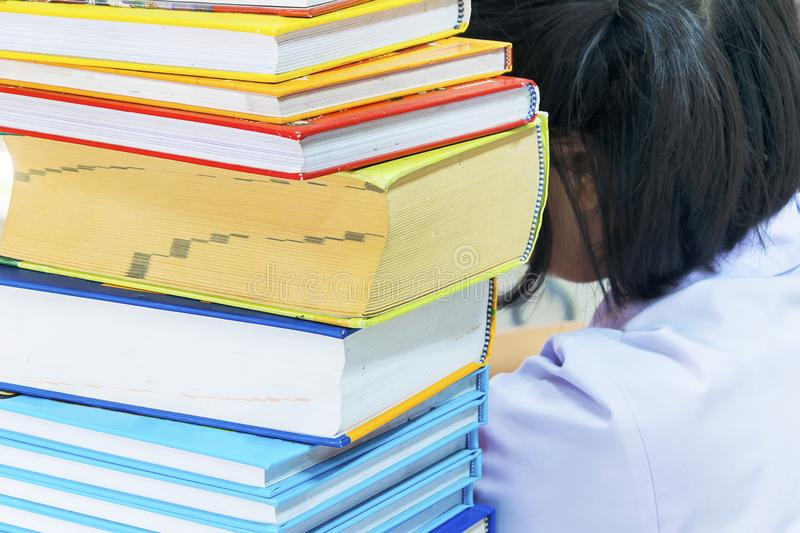 Books placed as high places. Education is very important for the nation`s development, students are intending to study, read books, books placed as high places stock images