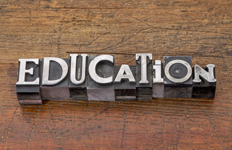 Education word in metal type stock photography