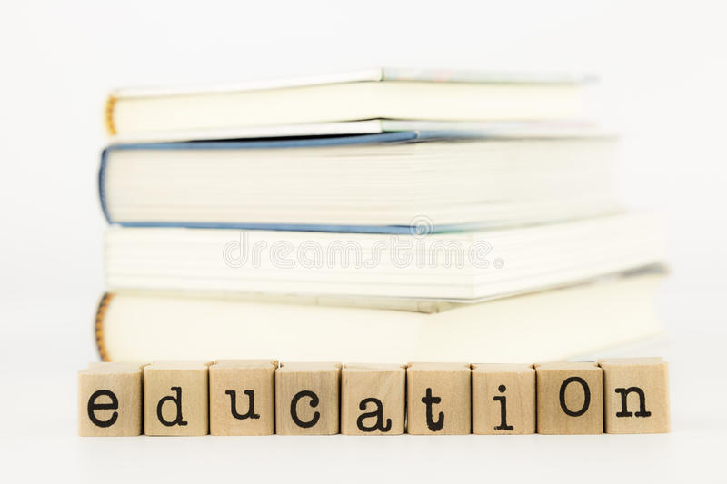 Education wording and books. Closeup education wording, learning and studying concept and idea stock photo