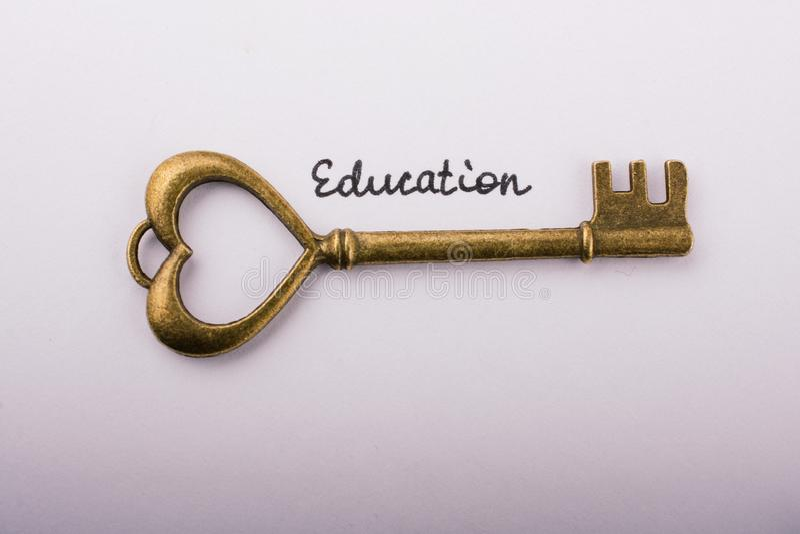 Education wording beside a retro style key on white background royalty free stock photos