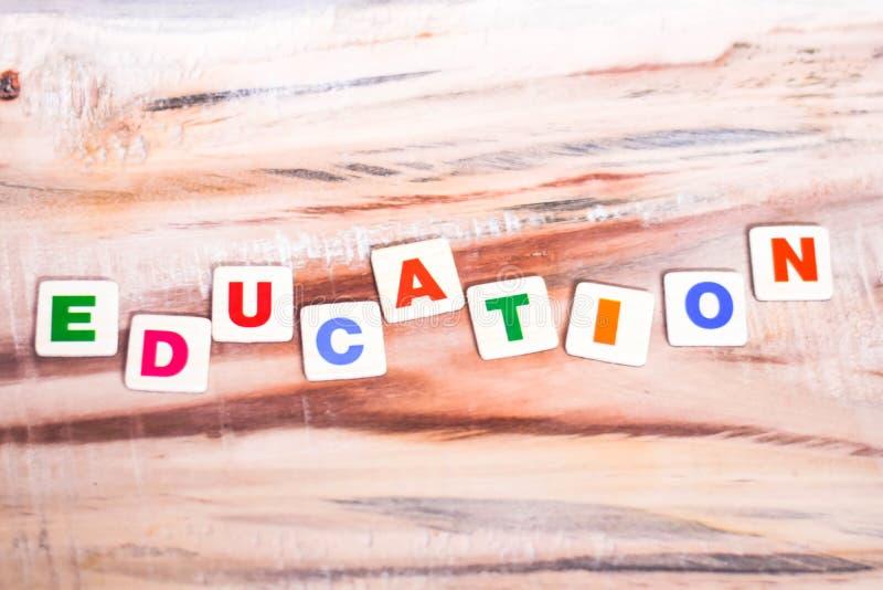 EDUCATION WRITTEN ON WOODEN TABLE stock photo