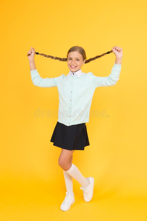 Educational activity. Homeschooling or visiting regular school. Efficiency of studying. Adorable schoolgirl. Happy. Schoolgirl. Schoolgirl happy smiling pupil royalty free stock image