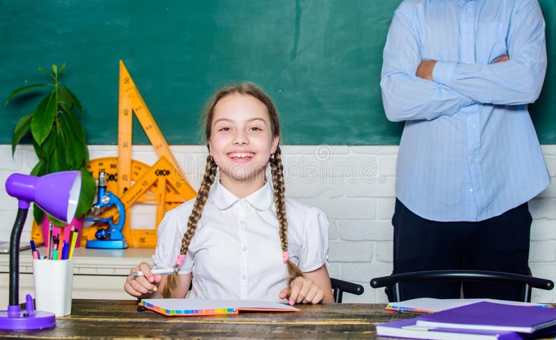 Educational concept. daughter study with father. Teachers day. back to school. knowledge day. Home schooling. bearded. Men teacher with small girl in classroom royalty free stock image