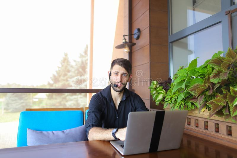 Educational consultant speaking with clients with laptop video c. Educational consultant talking to student by laptop video call with headset microphone stock photos