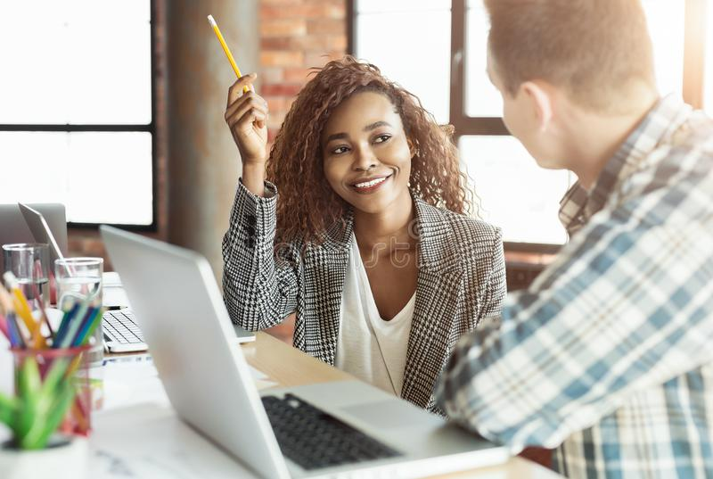 Black girl talking to professor at college. Educational consulting. African-american girl discussing coursework, sharing ideas with professor, copy space royalty free stock photos