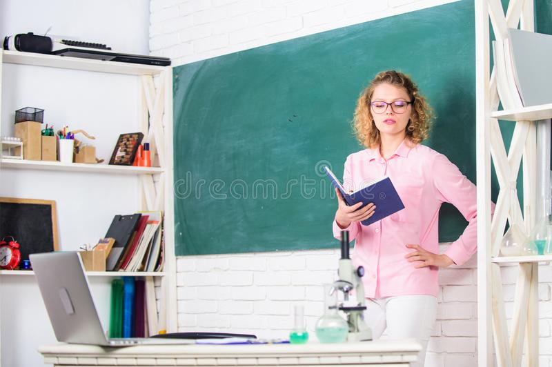 Educational program for primary school. Girl adorable teacher in classroom. Educational methods include storytelling. Discussion teaching training and directed stock photo