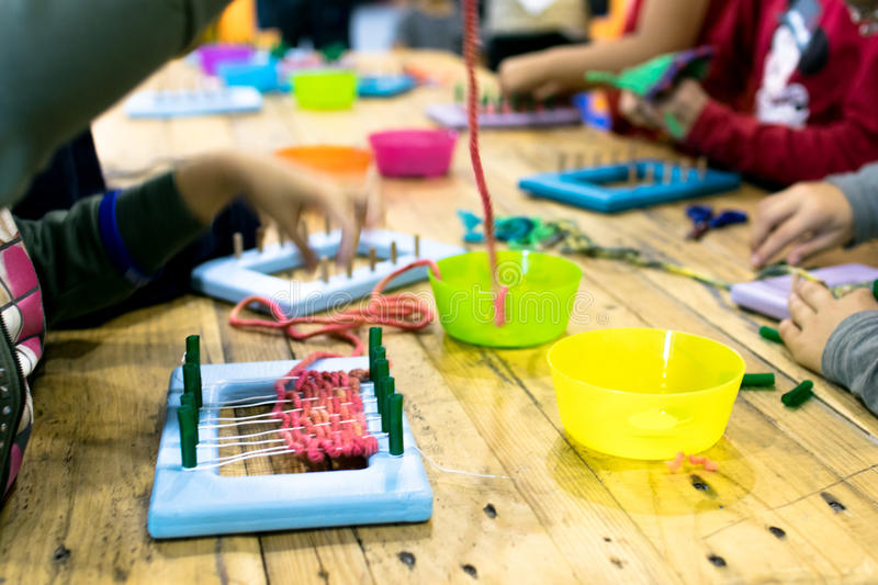 Educational weaving and knitting activity. stock images