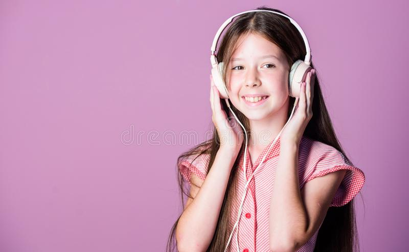 Educative content. Study english language with audio lessons. Girl listen music modern headphones gadget. Perfect sound royalty free stock photo