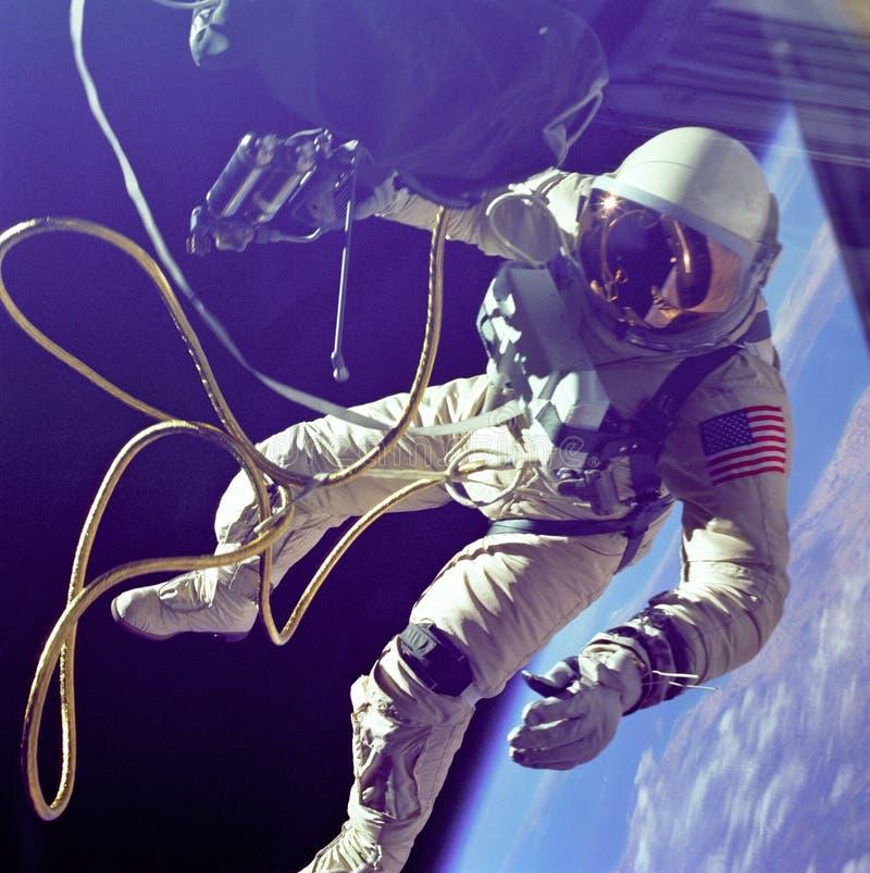 Edward H White conducting first american spacewalk