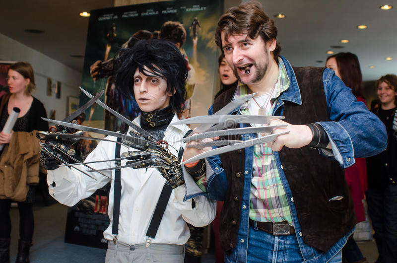 Cosplayers at East European Comic Con. Edward Scissorhands and Wolverin cosplayers at East European Comic Con, Bucharest, Romania 2013 royalty free stock photos