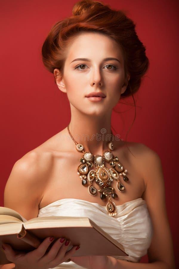Edwardian kvinnor för rödhårig man arkivfoton
