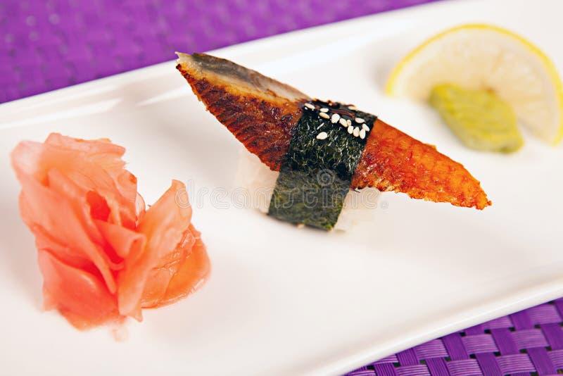 Eel sushi, wasabi ginger and lemon stock photo