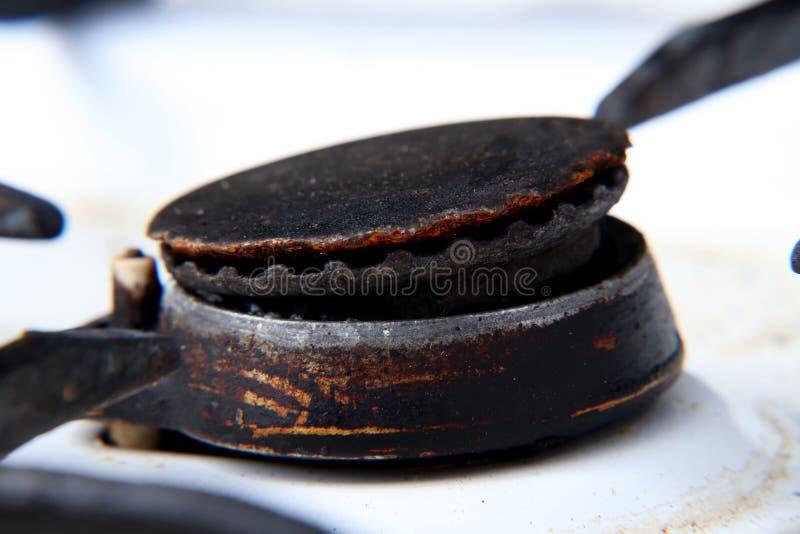 Een één zwart roestgasfornuis op wit kooktoestel voor opwarmingsvoedsel voor het eten royalty-vrije stock foto's