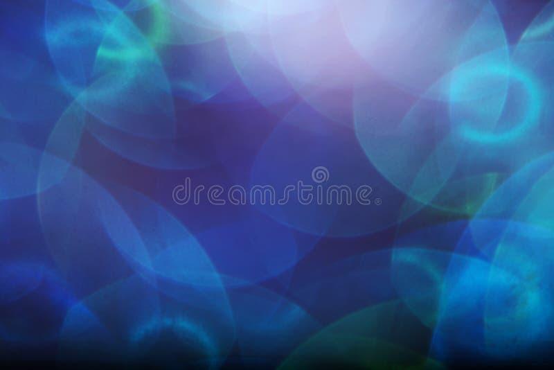 Een abstracte achtergrond van bokehlichten stock foto's